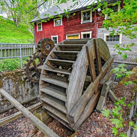 waterwheel: Water wheel with wooden gears in the Vaaksy Water Mill and Hydroelectric Power Station Museum in Asikkala, Finland. Editorial