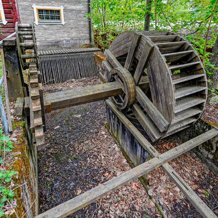 waterwheel: Water wheel with wooden gears in the Vaaksy Water Mill and Hydroelectric Power Station in Asikkala, Finland.