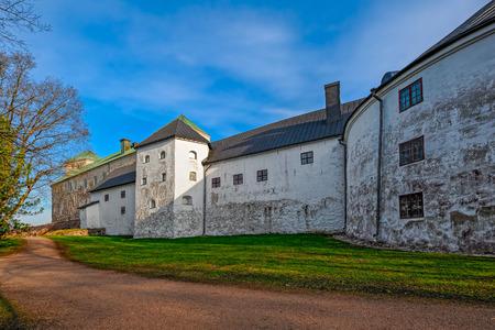 turku: Park around historic Turku Castle in Finland on a bright spring morning