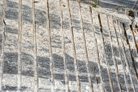quarry: Texture of rough cut italian marble from former Ruskeala quarry, Republic of Karelia, Russia