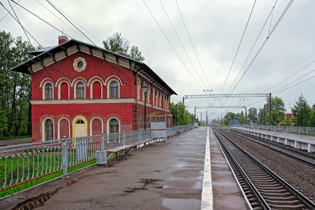 likeness: Railway station Strelna, built in the likeness of a medieval castle chapel in 1857 architect Nicholas Benois, at rainy day. Editorial