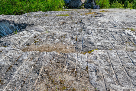 former: Texture of rough cut italian marble from former Ruskeala quarry, Republic of Karelia, Russia