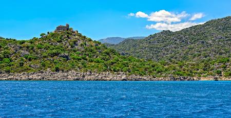 seljuk: Ruins of ancient fort on rocky Mediterranean sea coastline near Demre, Turkey.