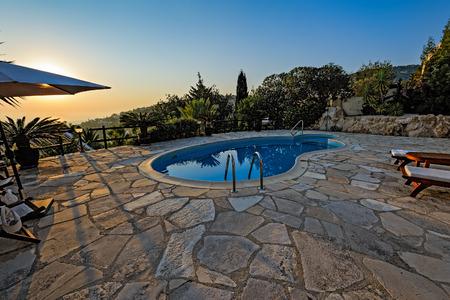 holiday villa: Swimming pool at holiday villa in Cyprus at sunset