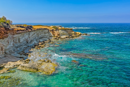 View from above to waves breaking on rocky coast of Cyprus island.