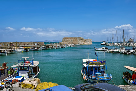 Port of the city of Iraklion and kind on the Venetian port with a fortress in island of Crete, Greece Editorial