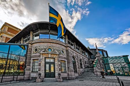 STOCKHOLM, SWEDEN - MAY 01, 2016: The Royal Swedish Opera (Kungliga Operan) house entrance with national flag in Stockholm, Sweden