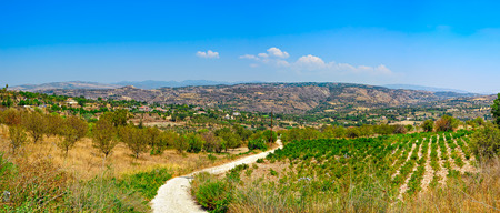 polis: Panoramic top view from mountain to Cyprus landscape with gardens, mountain villages and country road between hills