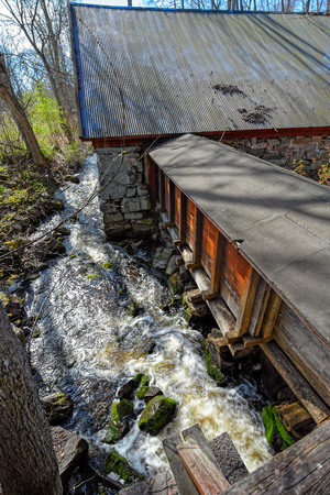 ironworks: Water running downhill from the Forge in Fagervik Ironworks, Finland Stock Photo
