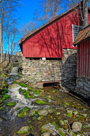 ironworks: Water running downhill from the Forge in Fagervik Ironworks, Finland Editorial