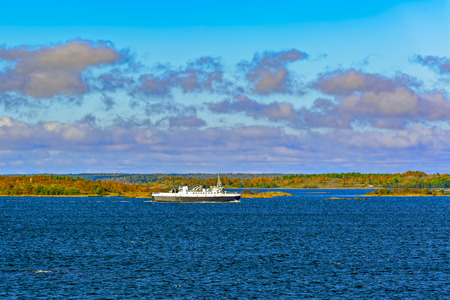starboard: Small local ferry on the route through the Aland archipelago with islands in the background.