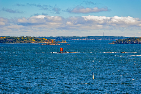 Marine signs and lighthouse in the Turku archipelago rocky island to help you navigate in shallow water Stock Photo