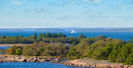 Small local ferry on the route through the Aland archipelago with islands in the foreground.