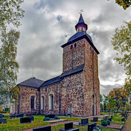 Church of St. Olaf is a medieval stone church in Jomala, Aland Islands at autumn. It belongs to the Evangelical Lutheran Church of Finland. Dating from about 1260 to 1280, it is possibly the oldest Christian church in Finland Stock Photo