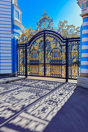 Gilded openwork gate of Catherine Palace - the summer residence of the Russian tsars in Tsarskoye Selo  (Pushkin), St. Petersburg, Russia.