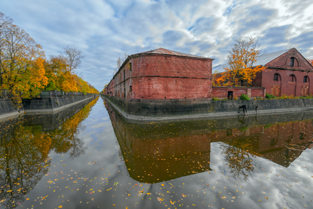 Ancient building of purveyance warehouse of Kronstadt Admiralty built in the years 1794-1795, architect Vasily Bazhenov, on the banks of the Obvodny (Bypass) channel. Kronstadt, Kotlin island, Saint-Petersburg, Russia Stock Photo