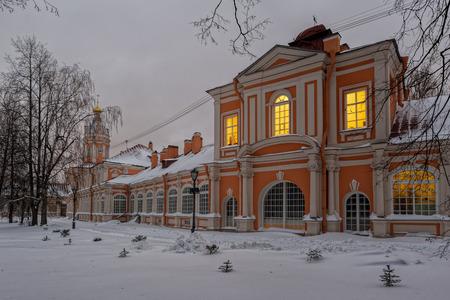 Lighted windows of Alexander Nevsky lavra at a frosty winter evening. Saint Petersburg, Russia. Editorial