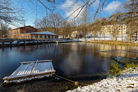 ironworks: Frozen copper pond and snow covered buildings of the former Fiskars Ironworks Village in Raseborg (formerly Pohja), Finland