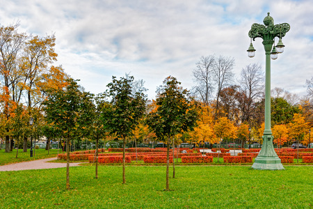 Ornate lamp post in autumnal park Stock Photo