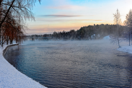 very cold: Cold fog over water of Kyronsalmi Straits at very low temperature (-30C) in Savonlinna, Finland Stock Photo