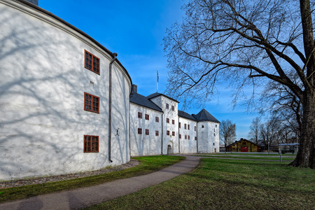 bastion: Park around historic Turku Castle in Finland on a bright spring morning