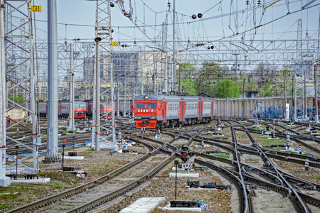 Modern red suburban electric train named Ladoga on the road of Finlyandskiy railway station in Saint-Petersburg, Russia Editorial