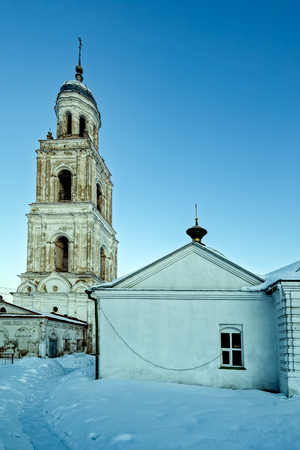 Belfry of Holy Trinity Cathedral Church in Poshekhonye small town, Yaroslavl region, Russia at very cold early winter morning