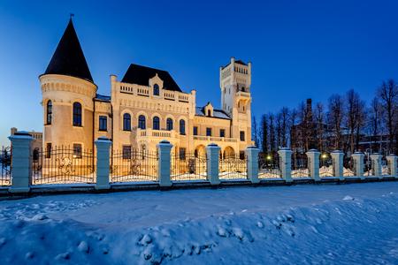 YAROSLAVL REGION, RUSSIA - January 03, 2017: Restored mansion of manufacturers Ponizovkin in the village of Krasny Profintern, built in pseudo-Gothic style in 1912-1914, at cold winter twilight. Yaroslavl region, Russia.