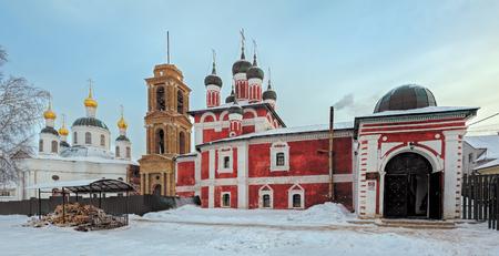 Orthodox Smolensk church of Mother of God icon and Theodore church of Mother of God icon in Uglich winter evening. Yaroslavl region, Russia