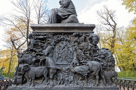 SAINT PETERSBURG, RUSSIA - October 20, 2016: Fragment of the pedestal of monument to Russian fabulist Ivan Krylov by sculptor Peter Klodt in the Summer Garden (Letniy sad) in Saint-Petersburg