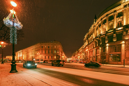 ST.PETERSBURG, RUSSIA - December 29, 2016: Beautiful night view of Nevsky Prospect near Palace Square in Saint Petersburg with snow blizzard and New Year and Christmas lighting decoration Editorial