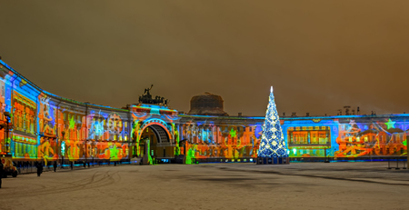 christmas military: ST.PETERSBURG, RUSSIA - December 29, 2016: Light-musical show with laser beams is projected onto the General Staff building in St Petersburgs Dvortsovaya (Palace) Square, at evening Editorial