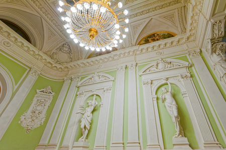 SAINT-PETERSBURG, RUSSIA - January 18, 2017: historical marble sculptures of Greek goddesses at the Wedding Palace on English Embankment in St. Petersburg. Ancient sculptures in the interior.