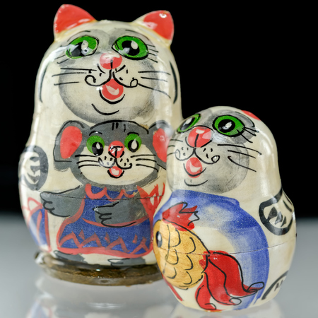 Set of Russian nesting dolls (babushkas or matryoshkas) in shapes of cat family