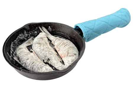 fish tail: Prepared for frying freshwater fish roach in a cast-iron frying pan before cooking