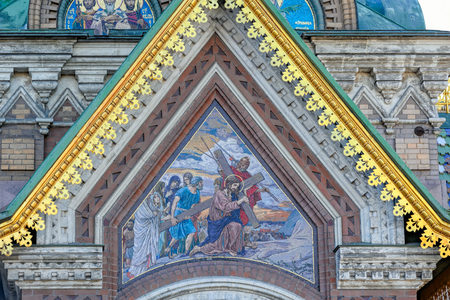 The elaborate facade of the Church of the Savior on Spilled Blood in Saint-Petersburg, Russia in the winter.