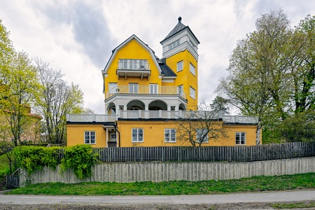 luxury apartment: Beautiful and luxurious yellow villa, built in 1906, in Stockholm neighborhood.