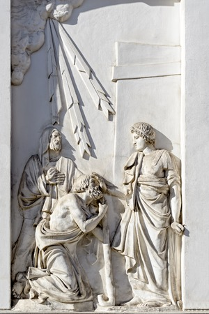 pestel: Bas-relief depicting St. Panteleimon, who heals the blind man on the south facade of the Church of great martyr St Panteleimon the Healer in St. Petersburg Stock Photo