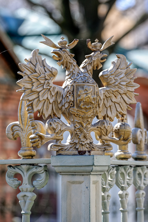 Details of fence decoration with bronze Russian Imperial Symbol of Double Headed Eagle
