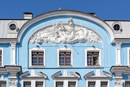 stucco facade: Bas-relief on facade of baroque style building of the former City School House of Peter the Great (1910-1912) by architect A.I.Dmitriev. Now Military-marine college by name of Nakhimov.