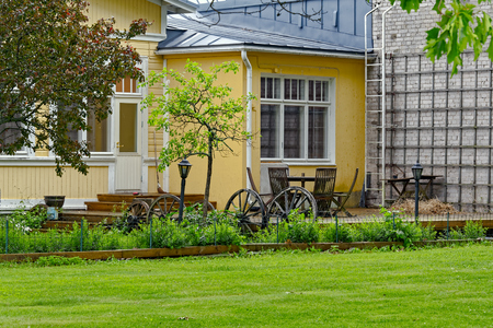 Backside terrace in the garden of a old charming Swedish-style cottage in Tammisaari, Finland at rainy day