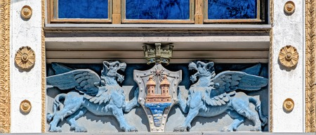 Richly decorated facade of the House of the Estates with bas-relief of Griffins with coat of arms.
