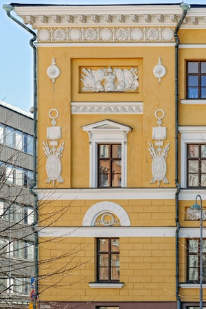 Bas-relief decoration with neoclassical features on bright yellow facade of army barracks of the Finnish Guard Kaartikasarmi by architect Carl Ludwig Engel (1822).