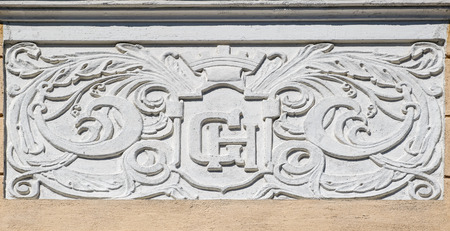 Bas-relief decoration with neoclassical features on bright yellow facade of building (1822) in Helsinki, Finland.