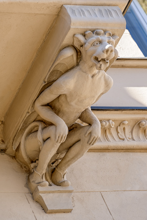 Grotesque stone figure on richly decorated facade of Art Nouveau style building. Helsinki, Finland Stock Photo