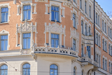Detail of Art Nouveau style building  with richly decorated facade by coats of arms and grotesque stone figures. Helsinki, Finland Stock Photo