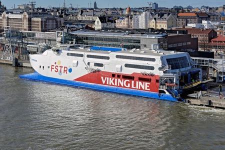 Cargo-passenger fast ferry catamaran FSTR Express by Viking line moored in South harbor at pier in Helsinki port.