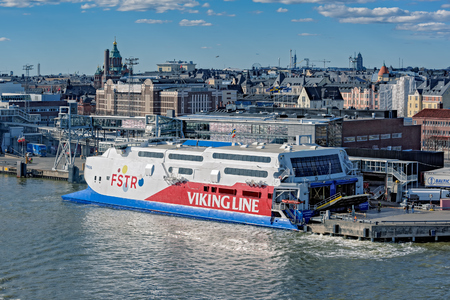 Cargo-passenger fast ferry catamaran FSTR Express by Viking line moored in South harbor at pier in Helsinki port.