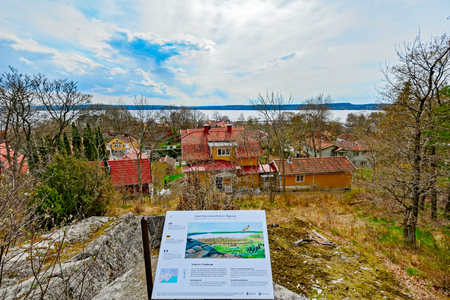 ochre: Painting showing what Sigtuna in Sweden used to look like during the Medieval Times and modern rooftop view to the town.