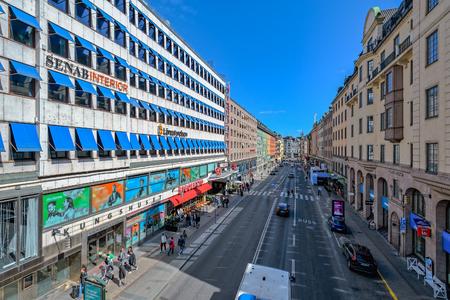 Midday activity on Kungsgatan (Swedish for Kings Street) from higher Regeringsgatan bridge. Editorial